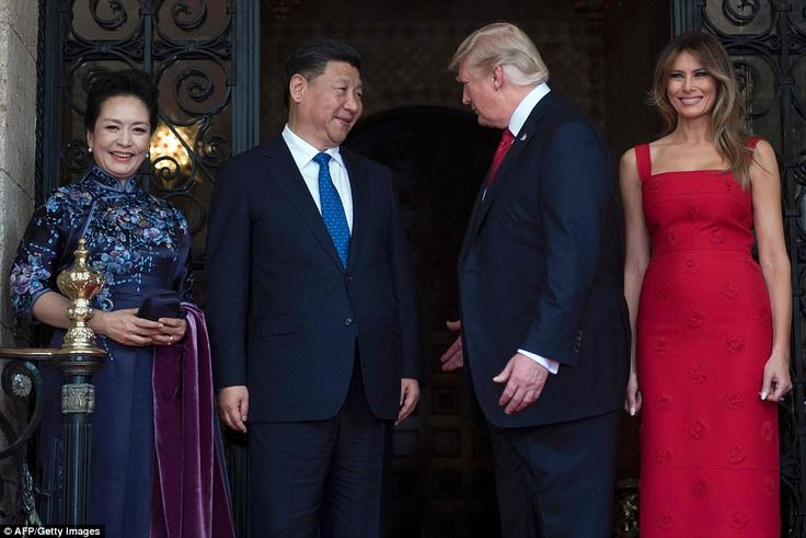 Chinese First Lady Peng Liyuan,Chinese President Xi Jinping, President Donald Trump and Melania. Red dress. 2017