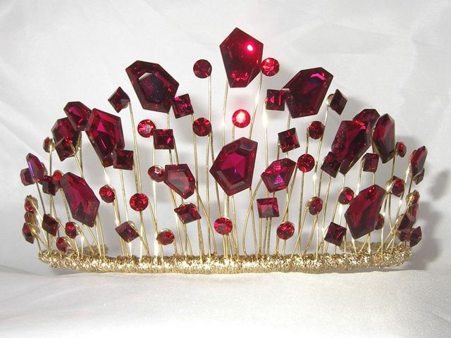A modern wedding tiara but well desgned and unusual....would make a great tiara to go with Ruby Slippers for an Oz theme!: