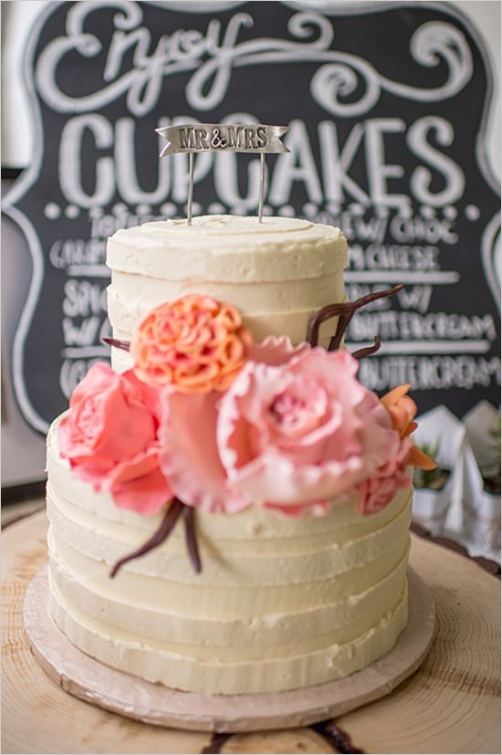 flower accented wedding cake by sugar cubed cake creations