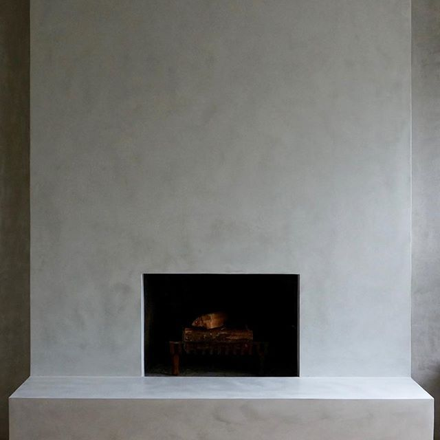 Polished limestone plaster applied over old brick fireplace to give it more contemporary look