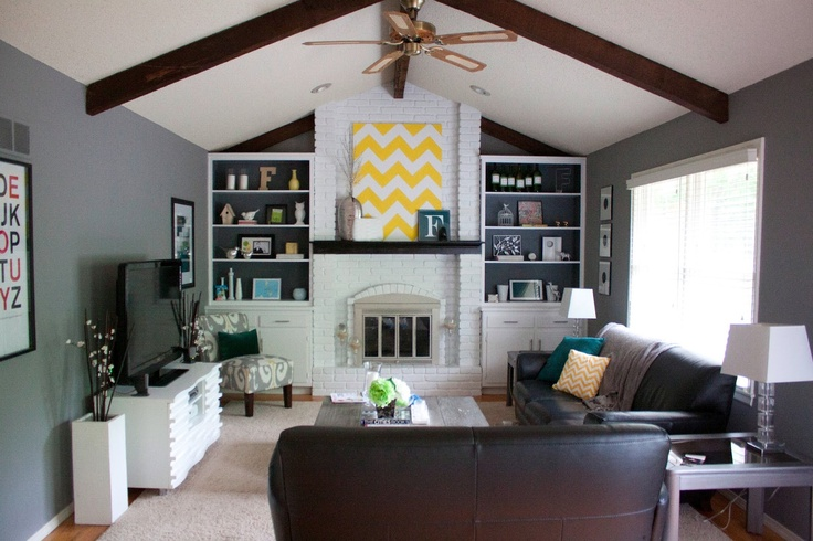 White painted brick with dark mantle (would be great for basement fireplace)