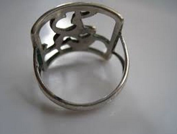 I B Jensen. Openwork silver ring with deer design. 830 silver. Marked 'BJ' and 830S. View 3/4.