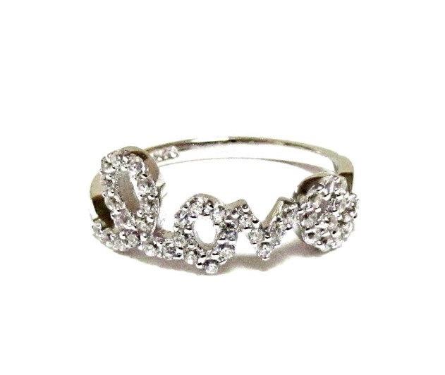 Rhodium Plated CZ Dainty Silver Rhinestone Love Ring. $48.00, via Etsy.