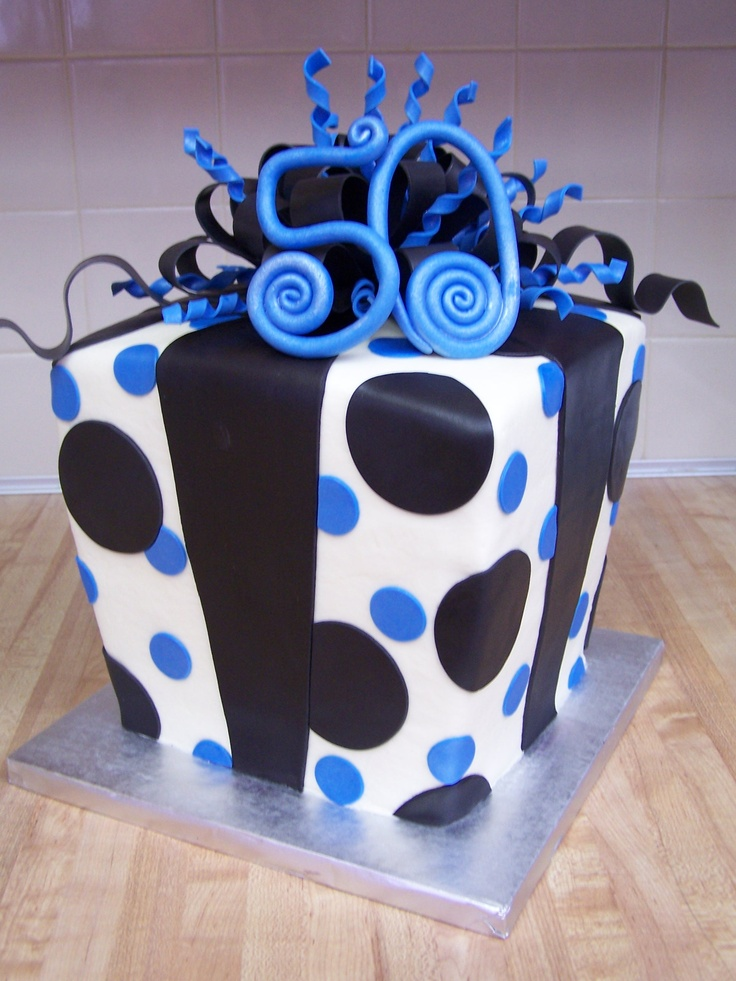 fun present cake...covered with buttercream and fondant accents!