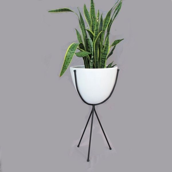 Large Bullet Planter Fibreglass planter with powder coated steel tripod baseDimensions: 76cm height x 41cm widthPLEASE NOTE WE ONLY SHIP WITHIN AUSTRALIA