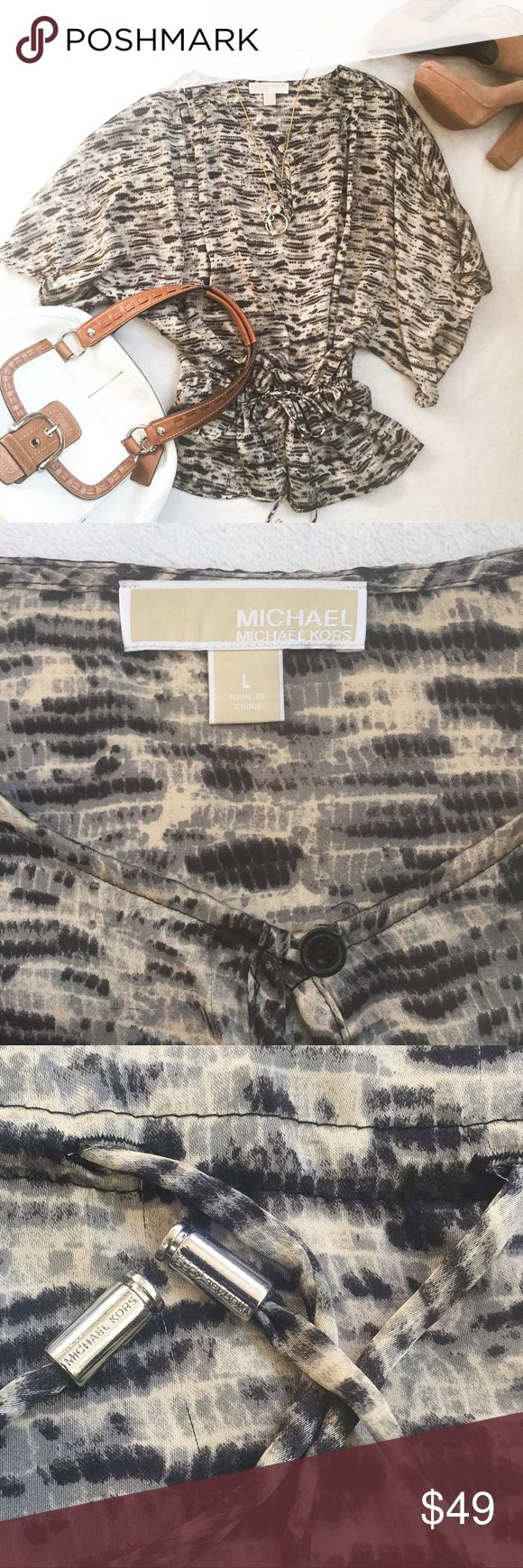 NWOT Michael Kors Batwing Kimono Blouse NWOT Michael Kors Batwing Kimono Drawstring Blouse. Never Worn, No flaws. Stunning Yet Casual Batwing/Dolman Sleeve Blouse from Michael Michael Kors. Drawstring Waist w/ Logo Stamped Hardwear. Silky Non-Stretchy Wrinkle Resistant 100% Poly Fabric. Great Neutral Color Pattern. Comfortable & Flattering Style. MICHAEL Michael Kors Tops Blouses