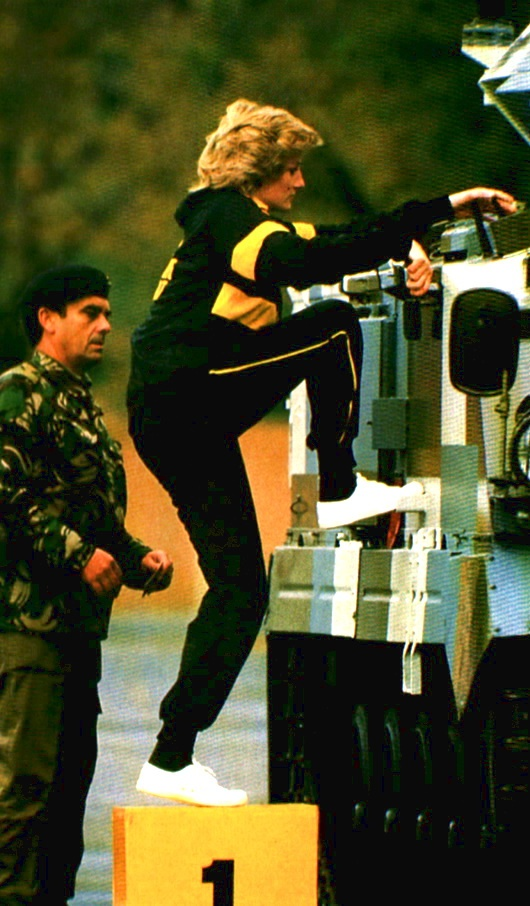 19 October 1985: Princess Diana, Colonel-in-chief of The Royal Hampshire Regiment wearing a regimental track suit taking a driving lesson in a 15-ton tank in the parade ground during her visit to the regiment when serving in West Berlin, Germany.