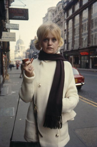 Goldie Hawn holding a pipe, in London.  And holding appears to be all she's doing with it.