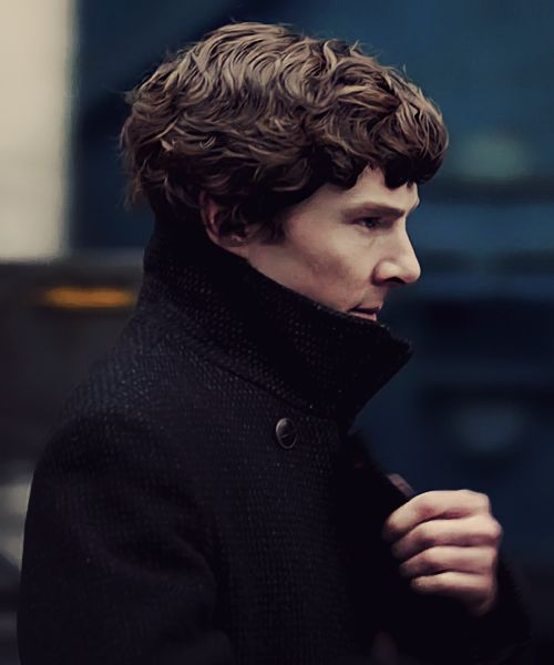 Benedict Cumberbatch as Sherlock, with the collar flipped up on that wonderful Belstaff coat.