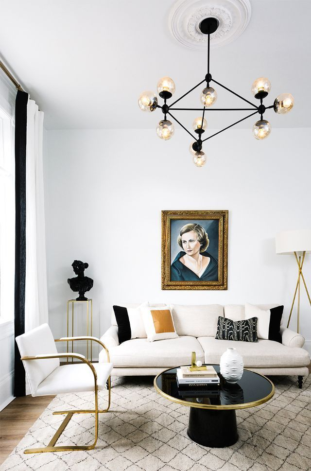 Notice how the cleavage in the portrait echoes the cross legs of the floor lamp. Shapes play their part, softly graphically, throughout the whole room. Townhouse Décor Ideas — Living Room