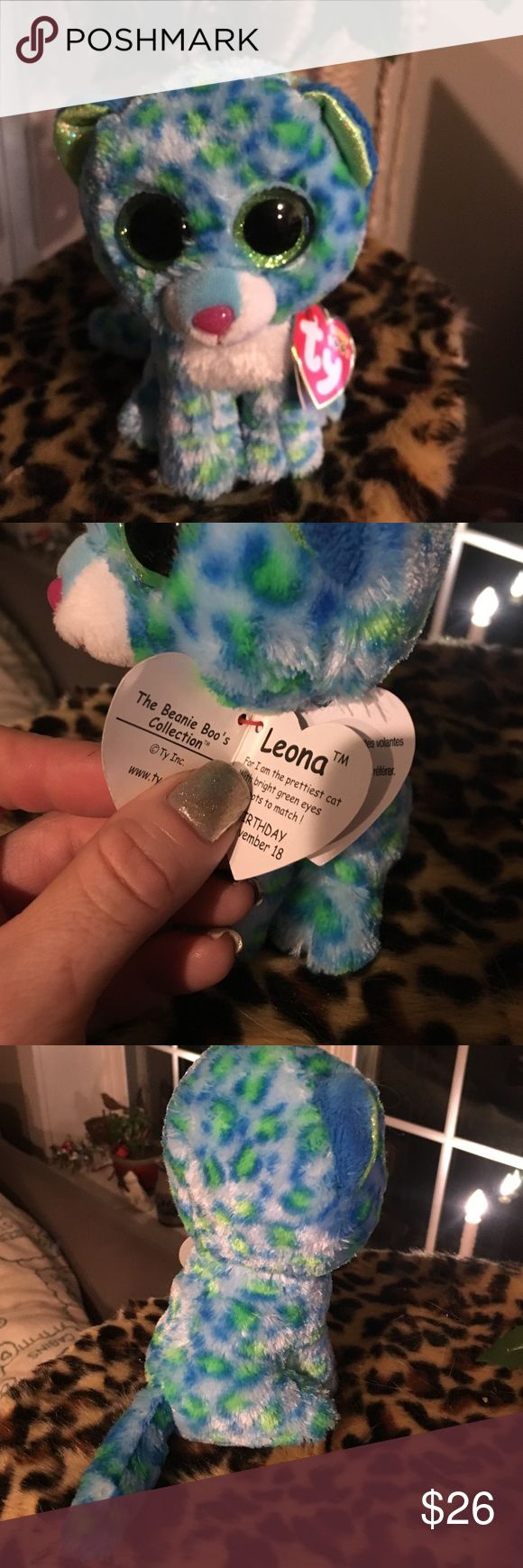 Leona ty beanie boos About 5/5.5 inches high this small beanie baby(Leona) is a collectors doll. Very cut and soft. Pet and smoke free home.  She is a beautiful bright blue with sparkly green eyes and glitter accents. Adorable. Brand new. From ty company. ty Other