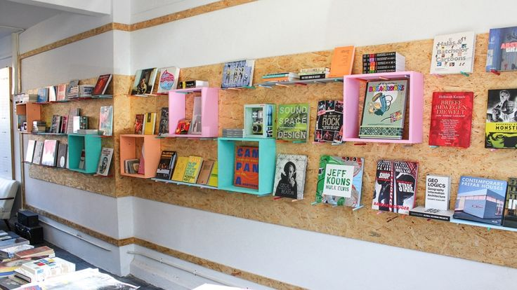 Pegging Board by Kraftisan plus simple wooden crates makes for a great book display.