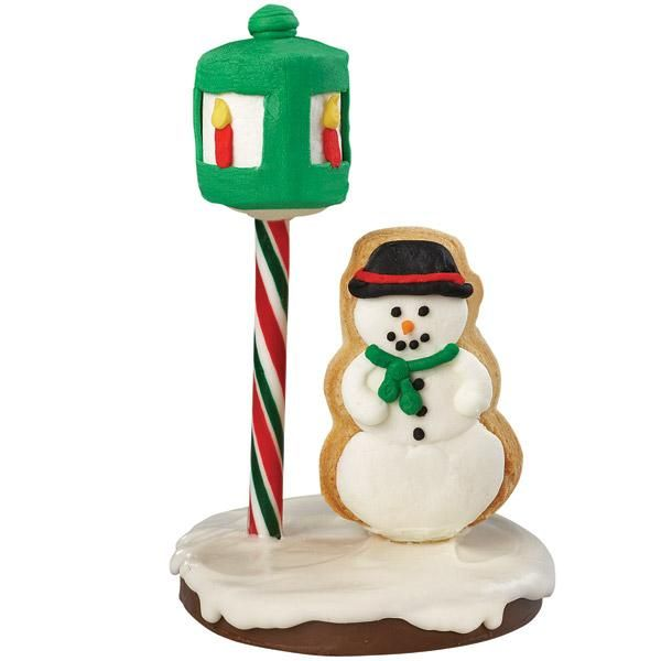Snowman in the Spotlight Cookie - Frosty's gone to the square to have some fun! This lyrical  scene has a candy base, cookie snowman and decorated  marshmallow lamplight.