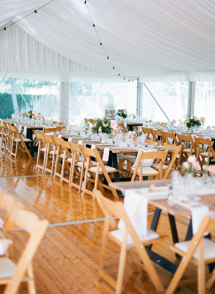 marquee structure, silk lining, festoon lighting, integrated timber flooring, wooden padded folding chairs, vintage timber tables, south coast weddings, marquee weddings, south coast party hire