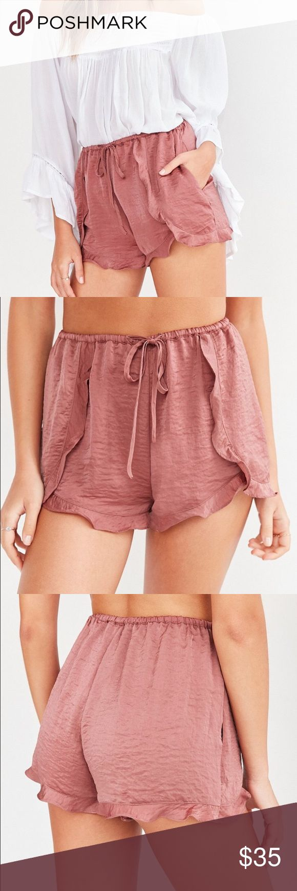 UO Crinkle Satin Ruffle Shorts (S) *NEW:NWT* Floaty, romantic ruffle-hem dolphin shorts in softly crinkled satin from UO's forever feminine label, ECOTE.   * Mid-rise  * Pull-on * Adjustable tie at waist * Side pockets * Polyester * Hand wash * Imported  Size:     SMALL Color:   MAUVE Retail:   $54.00  *** NEW WITH TAG *** Urban Outfitters Shorts