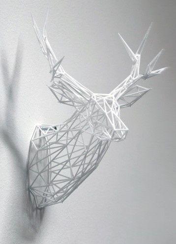 3-D Printed Stag Sculpture - De oplossing voor mensen die een hert aan de muur willen, maar tegen dierengeweld zijn. Dit hert is heel erg realistisch, terwijl het heel modern is door de geraamte. Het hert is opgebouwd uit allemaal rechte lijnen, ribben. De rechte lijnen zijn in elkaar gevlochten tot een realistisch beeld. Het hert is hol en daardoor modern en strak. De witte kleur zorgt ervoor dat het lijkt alsof het hert zijn kop door de muur steekt. Een kloppend geheel.
