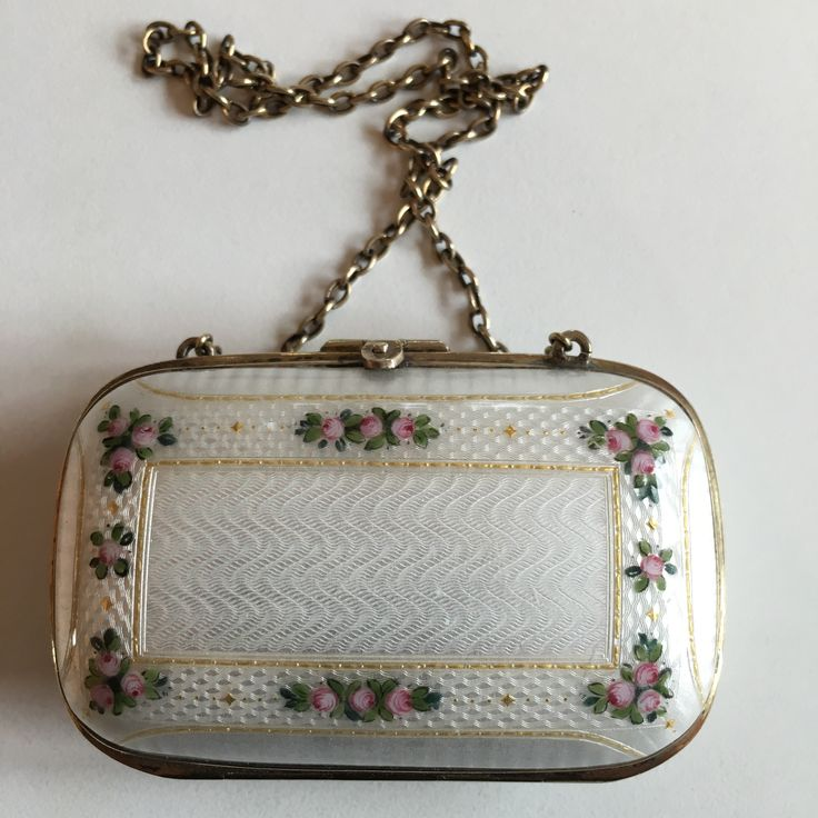 Gustav Gaudernack design for David Andersen. Silver gilt guilloché enamel purse with painted rose motif. 1905-1910