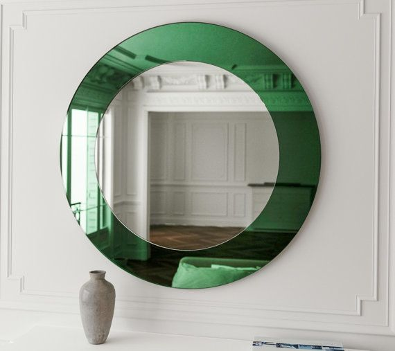 Green wall mirror. Round, Art Deco inspired frameless mirror with interesting green glass.  Looking for a sample of this glass? Order a sample