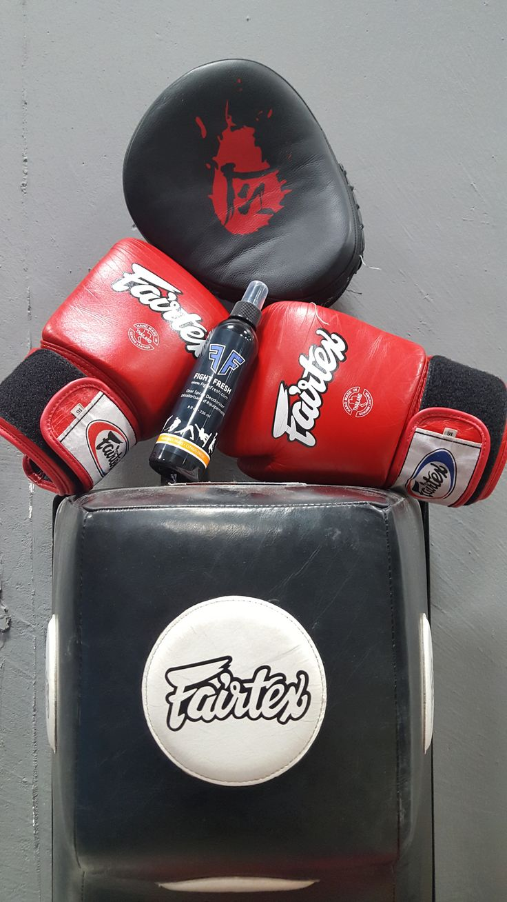 Keep you boxing and mma gear smelling fresh wirh this natural gear spray: http://fightfresh.com/product/citrus-gear-spray/  Lemon and Orange essential oils have deodorizing and antimicrobial properties that keep the stink away...use as often as you train. Why stink when you can Fight Fresh!