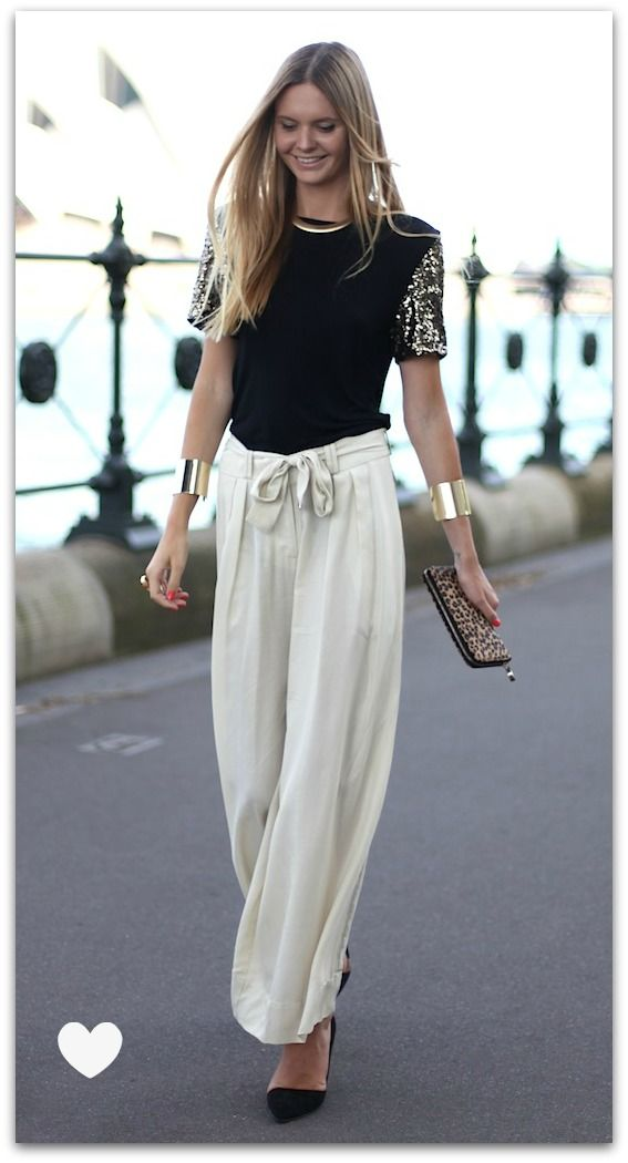 white palazzo pants with a bow gold cuffs the fashion co