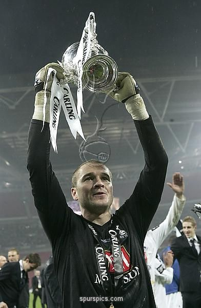 LONDON - FEBRUARY 24: Paul Robinson of Tottenham Hotspur celebrateswith the trophy following the Carling Cup Final between Tottenham Hotspur and Chelsea at Wembley Stadium on February 24, 2008 in London, England. Tottenham Hotspur won 2-1 after extra time