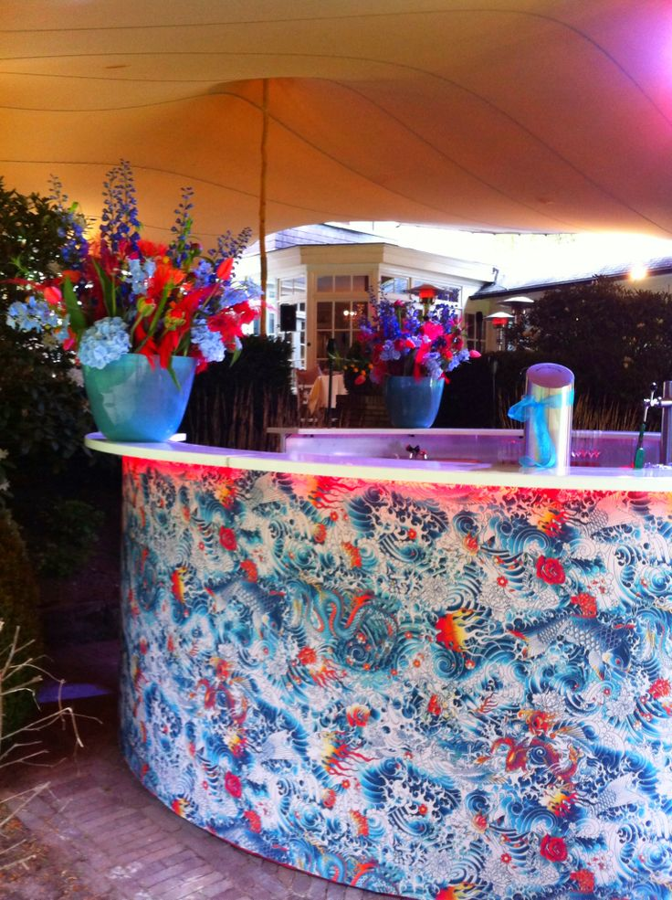 Festival Wedding Bar! Design by Studio Raef -Fabric by Jean Paul Gaultier - Flowers by Menno Kroon.