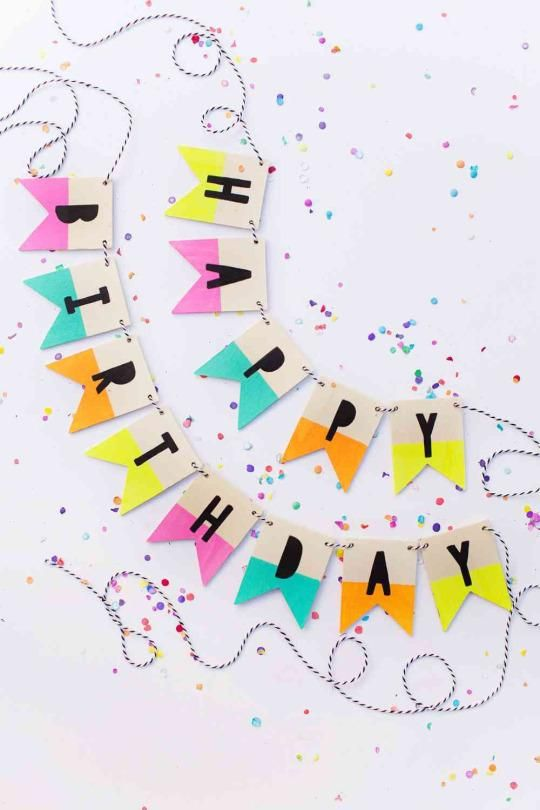 """This wooden """"Happy Birthday"""" garland is something that you can string up and use over again. Paint a pack of banner tiles (in the wooden shapes section of your craft store) to make one that works for your favorite reoccurring celebrations."""