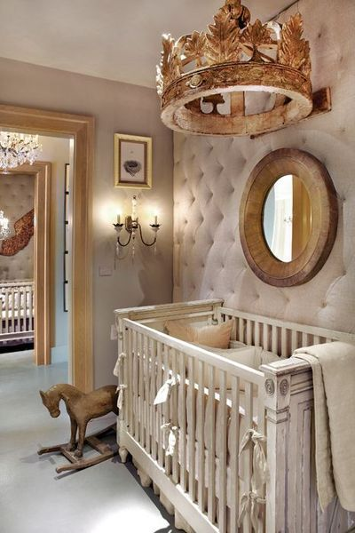 Nursery in Shades of White. Oh my! That tufted wall and the crown above the crib.