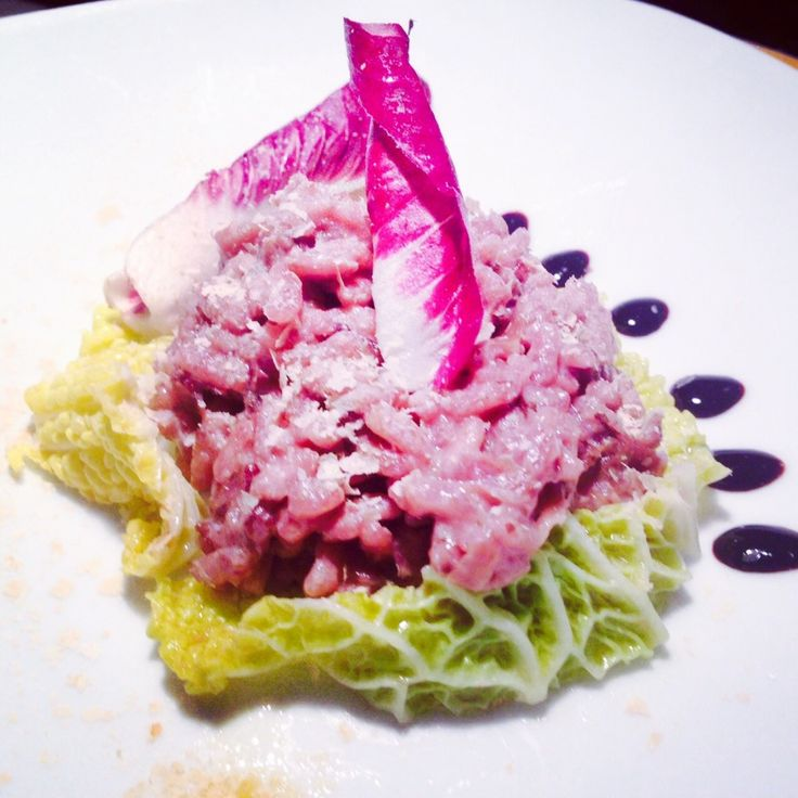 Radicchio Trevigiano RisottoThis is my new recipe...I garnished this first course with some leaves of savoy cabbage steamed sautéed in a pan with a drizzle