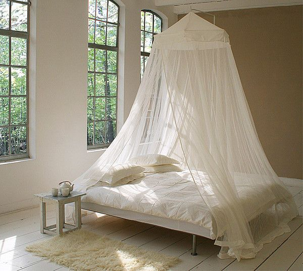 """This King Size Mosquito Net has a canopy top, a circumference of 1400cm – 45'11""""ft/in and a height of 265cm – 8'8""""ft/in. It is suspended from a single point above the bed and is suitable for queen- and king-size beds. If desired, you can drape this model over a bedside table. It is also large enough to hang behind a headboard. You even have the option of hanging the Mosquito Net towards the head of the bed, so that more space is available up front.  Buy @ mosquitonetcollection.com"""