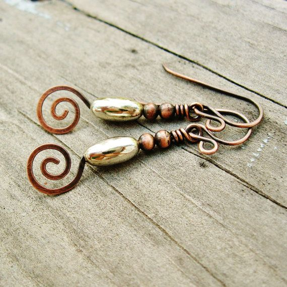 These are great mixed metal dangle earrings featuring silver and copper. An oval shaped silver plated melon bead topped with antiqued copper