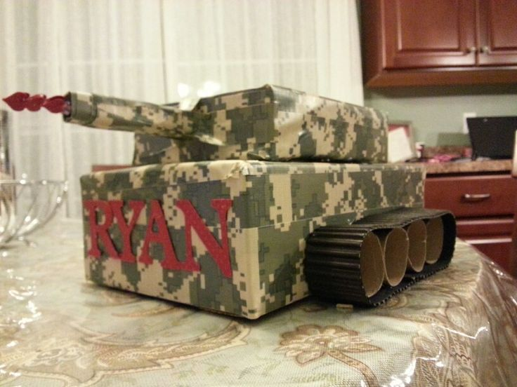 Boys Valentine's box  Camo duct tape, cut up paper towel roll for wheels.