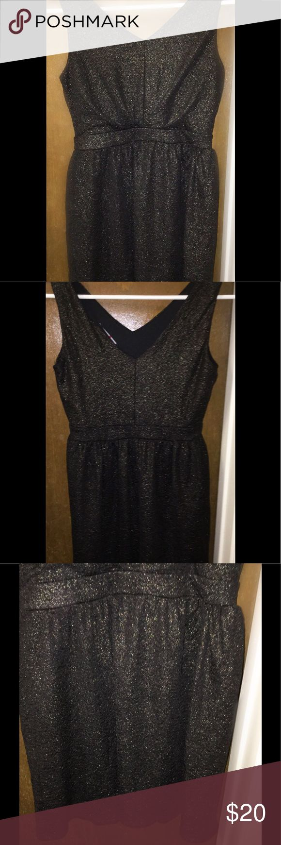 One Clothing Sz Large Sparkly Brown Cocktail Dress This is a sparkly brown-black cocktail dress from One Clothing. It is a size large. It has a deep V-neck and even deeper V-back. This is sleeveless with a belted waist and flowy skirt. Excellent condition. No rips or stains or tears. This is a great dress for a night out. one clothing Dresses