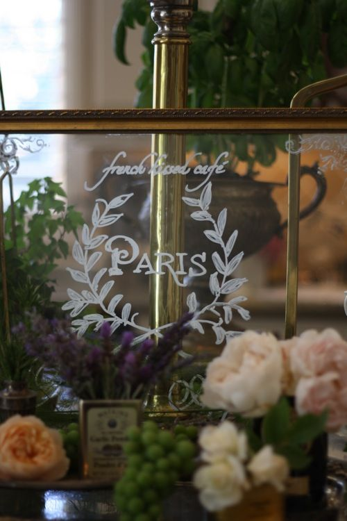 large vintage gilded poster frame... (with just glass, like a window)... Parisian wreath drawn with white marker... elegance