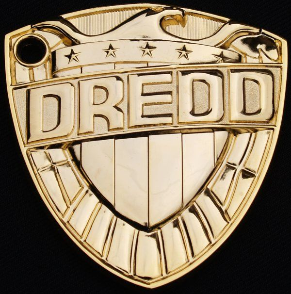Judge Dredd badgeNmade by Michael Carroll,based on a design by former art editor,Robin Smith.  Plated in 24 carat gold.