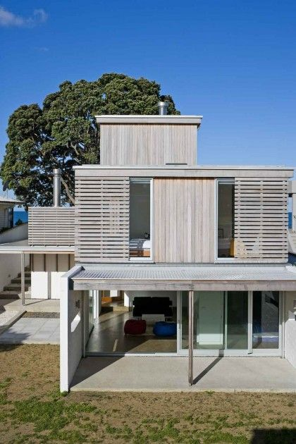 Nice combination of vertical + horizontal.  Those are sliding exterior shutters - a much better way to reduce internal heat build up.