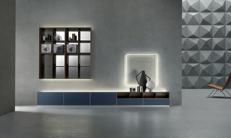Self composition with base on the fl oor, storage units with fl ap doors in matt blu notte lacquered glass, matt caffè lacquered open modules, upper led backlight.