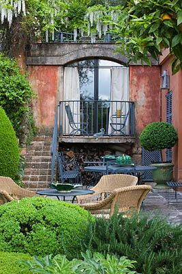 A courtyard in Provence: I love all of the muted colors: blue, red, green, and yellow.                                                                                                                                                                                 More