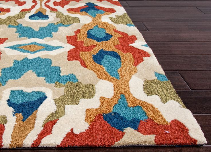 With bold color and large-scale designs, the Brio Hand Tufted Rug packs a powerful design punch at a reasonable price. hardwood floors, wood floor decor, area rug, brio, hand tufted rug