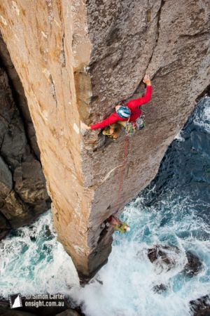 Doug McConnell leading, with Dean Rollins belaying, on The Ewbank Route (aka The Freed Route), which they freed at grade 27 in January 2009, on the 65 metre Totem Pole, at Cape Hauy, Tasmania, Australia.