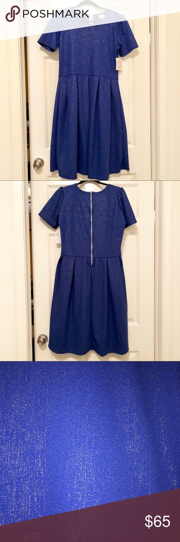NWT LuLaRoe LTD Edition 2017 Holiday Amelia Dress NWT Rare Limited Edition Size XL beautiful and sparkling cobalt blue and gold shimmer LuLaRoe Amelia Dress with pockets !  This dress features a beautiful sparkling gold thread thru out the dress . Dress has  pockets and has a nice stretch to the dress but still holds its shape & has a zippered back. Item is new with tags and only worn to try on .Please feel free to ask questions🙂 All offers considered LuLaRoe Dresses