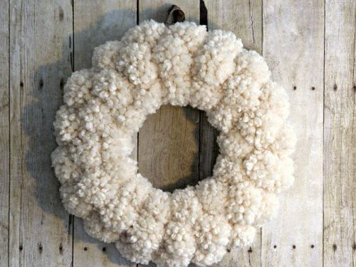 How to Make Anthropologie Inspired Pom Pom Wreaths. See how to make a rustic yet soft and puffy yarn wreath for your home.