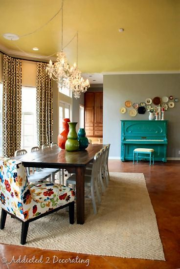 colored ceiling, neutral wall, bright, bold furniture and accessories