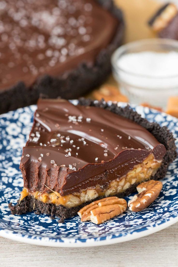 Salted Caramel Pecan Chocolate Pie has an Oreo crust, a salted caramel pecan layer, and a thick chocolate ganache layer topped with sea salt!