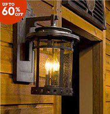 Light up your landscape with fresh-air sconces, lanterns, and other luminaries. Flush mounts featuring hand-blown glass make an artful addition to your front porch, while slate-backplate styles add southwestern style to any outdoor area. Choose a charming post light to guide you and your guests from the driveway to your doorstep.