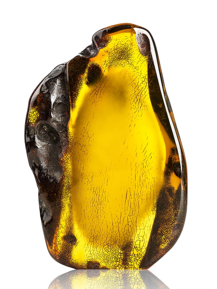 Yellow transparent Baltic Amber Stone ( 429.2 g.)  €4,708.00  This piece combines a variety of colour and ornaments that nature created. It's like a range of desert shades with clouds see through.  Size: 165 x 114 x 40 mm Weight : 429.2 g.  www.amberauctions.com