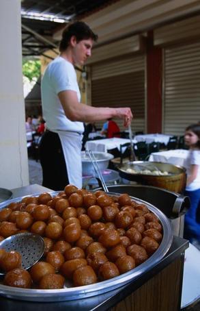 Loukoumades - greek dessert, fried dough soaked in honey and walnuts..omg Nick is gonna freak when I make these!  My absolute fav Greek dessert!!