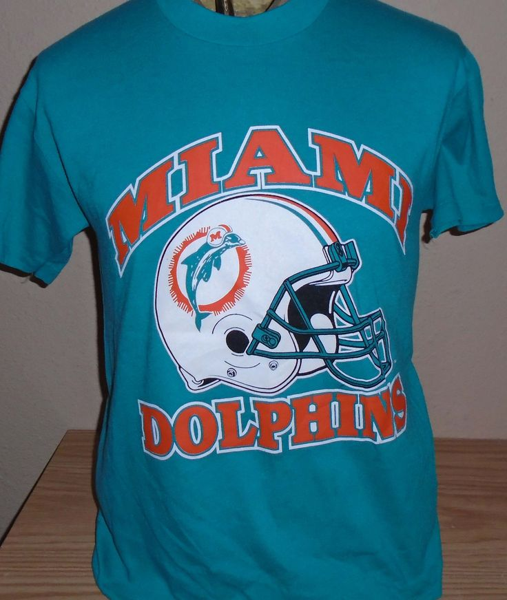 FREE Shipping vintage 1980s Miami Dolphins football t shirt Medium by vintagerhino247 on Etsy