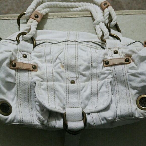 White cargo style Gap purse rope handles White cargo purse from gap  Purse has multiple outer pockets, large zipper compartment inside and 3 pocket compartments inside.  Features rope handles and leather accent detail  Purse may not look very big but it can fit A LOT!!!  there are a few areas of  small discoloration on outer side...as can be seen in photos. Inside of purse also hard discoloration but obviously this cannot be seen from outside.  I have more photos, please comment with email…