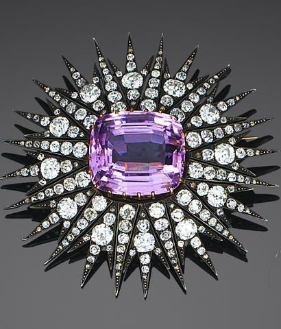 A late 19th century kunzite and diamond brooch/pendant, circa 1880. Designed as a sunburst, the rays pavé-set with cushion-shaped and old brilliant-cut diamonds, with a claw-set cushion-shaped kunzite to the centre, mounted in silver and gold, detachable brooch fitting. #antique #brooch